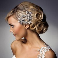 Bride with hair up and silver flowers in hair